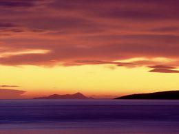 Sunrise with the island Agios Georgios