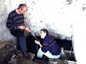 Greek geologists measure gas temperatures. (c) Tobias Schorr 1996