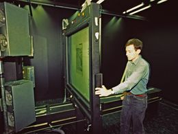 Dr. Lorenz Hurni at the huge reprographic camera of the university ETH-Zurich. 1991. (c) Tobias Schorr
