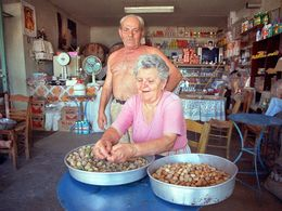 A historical photo of Mr. and Mrs. Betsis cleaning the almonds. For a long time they had a small mini market in the village. (c) Tobias Schorr 1994