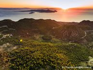 The rising sun over the Saronic gulf with the volcanic island of Aegina and the Stavrolongos crater. June 2016. (c) Tobias Schorr