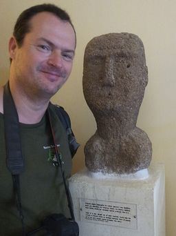 """Tobias Schorr & the """"antique"""" stone head that supposedly represents """"folk art"""" from the 19th century. Photo A. Triantafyllou 2014"""